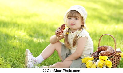 Girl eat bread and sitting in the m