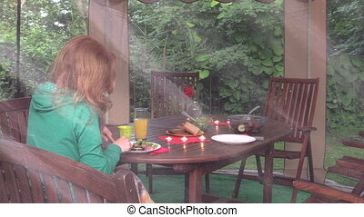 girl eat dinner gazebo - blonde woman eat backed meat alone...
