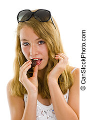 girl eating a chocolate truffle