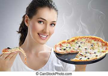 delicious pizza - Girl eating a delicious pizza
