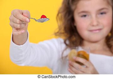 Girl eating a fruit salad