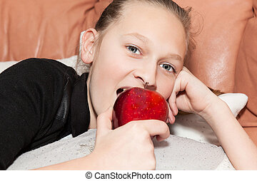 girl eating a red apple