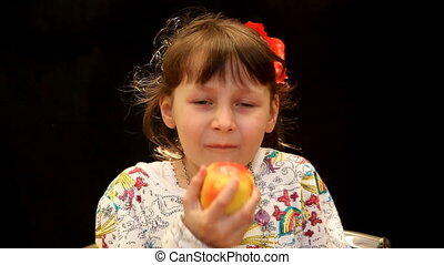apple - Girl eating an apple