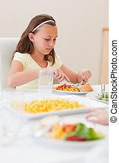 Girl eating at dinner table