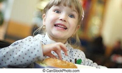 Girl eating big burger.