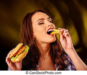 Girl eating big sandwich. - Girl eat with appetite fastfood...