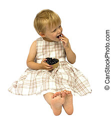 Girl eating blueberries, isolated on white background