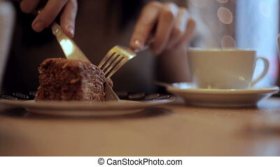 Girl eating cake and drinking coffee in cafe - Girl eating...