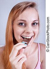 Girl eating chocolate bar
