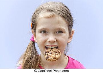 Girl eating chocolate cookies