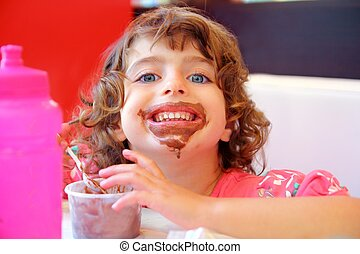 Girl eating chocolate ice cream dirty face having fun