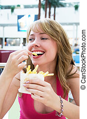Girl eating french-fries