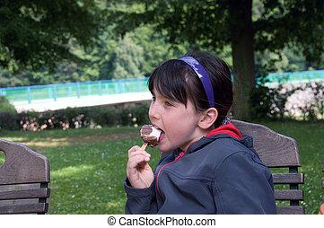 Girl eating ice cream.