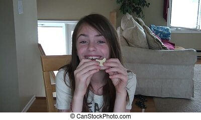 Girl Eating & Laughing at Table