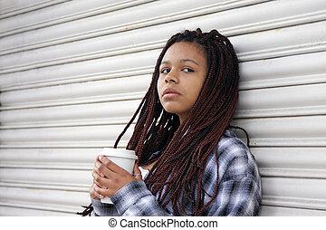 girl eating on the street