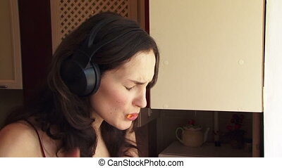 Girl eating orange - The girl in the big headphones eat...