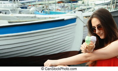 Girl eating popsicle icecream looking cute near sea shore and boats hd