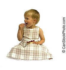 Girl eating raspberries, isolated on white background