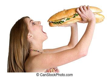Girl Eating Sandwich - Pretty teen girl eating large ...