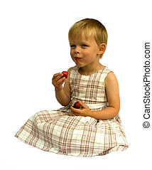 Girl eating strawberries, isolated on white background