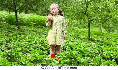 Girl eating strawberries