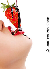 girl eating strawberry with chocolate sauc