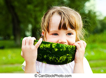 girl eating watermelon