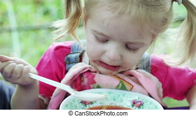 Girl eating with spoon