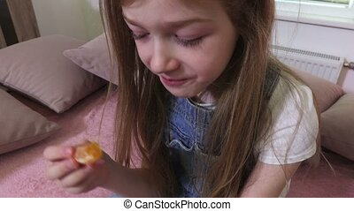 Girl eats mandarins