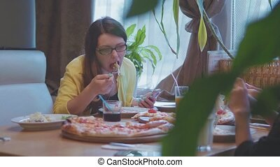 girl eats pizza in cafe fast food slow motion video keeps...