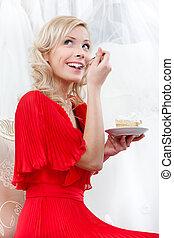 Girl eats the wedding cake