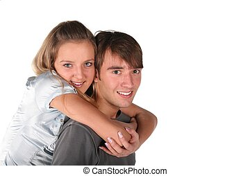 girl embraces boy from back on white