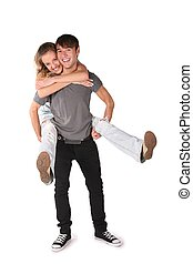 girl embraces boy from behind, he holds her on the hands for the legs on the the white