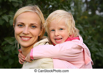 girl embraces the mother