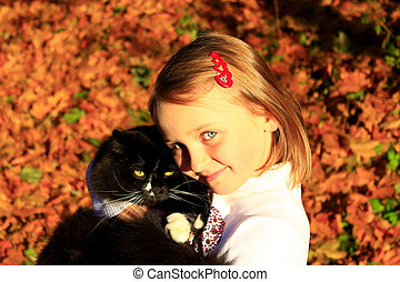 girl embracing with her cat in Autumn