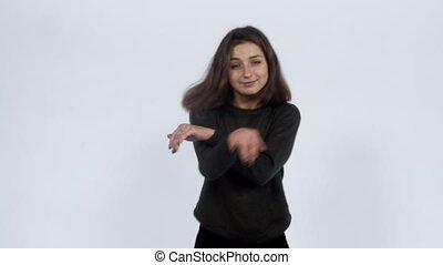 Girl energetically dances in the studio