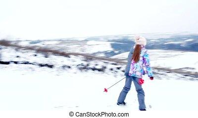 Girl enjoing winter while skiing - Little girl enjoying...