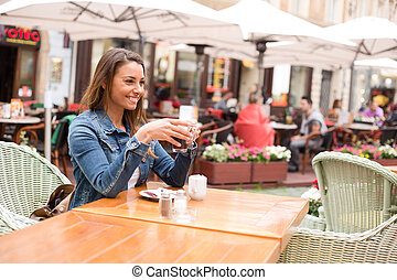 girl enjoying a coffee
