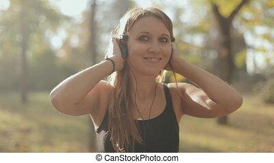 Girl enjoying music in headphones