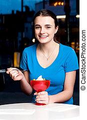 Girl enjoying tempting dessert