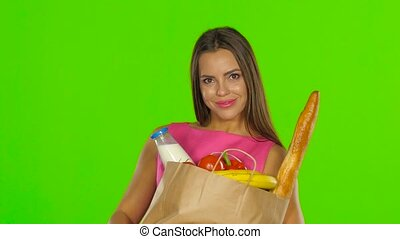Girl enjoying the aroma of the products. Green screen. Close up