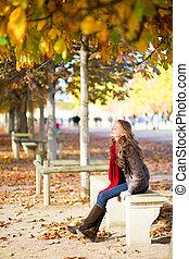Girl enjoying warm autumn day in Paris