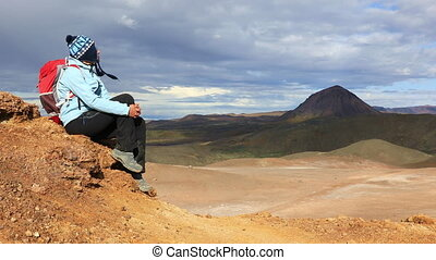 Girl enjoys stunning views of Icelandic landscapes - Girl...