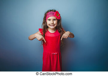 Girl European appearance haired child of seven in red bright...