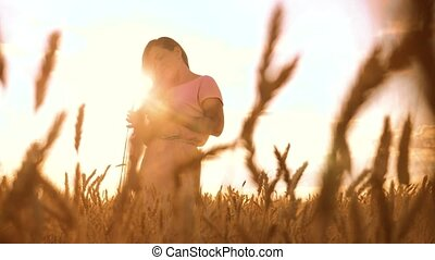 girl evening is standing in in the wheat field nature slow...