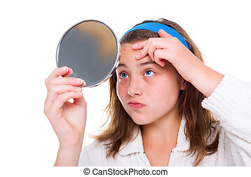 Girl examine her pimples in the mirror - Teenager girl...