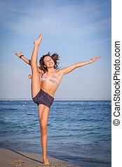 girl exercising on beach