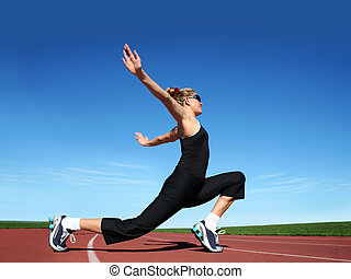 Girl exercising - Young pretty woman exercising on a...