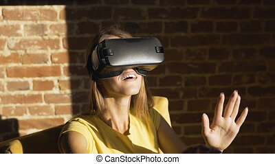 Girl Experiences Virtual Reality Helm - Fair hair caucasian...
