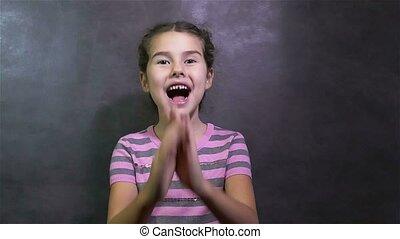 girl experiencing teen surprising happiness joy gray...